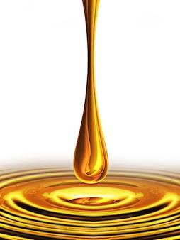 Spadająca kropla oleju na białym tle