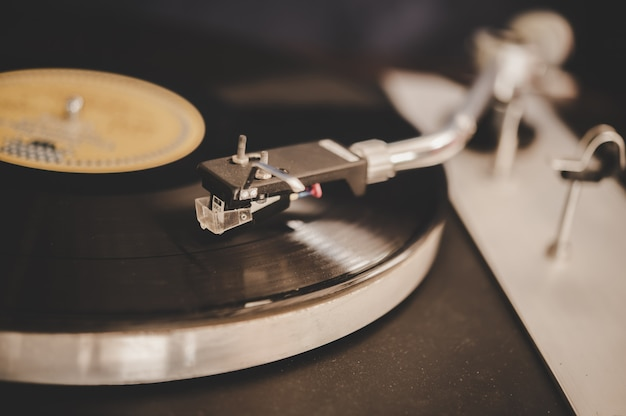 Spinning record player with vintage vinyl