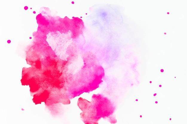 Splash i krople barwnika fuksji