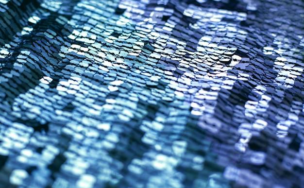 Splendoru tło z błyszczącymi błękitnymi cekinami na tkaninie, makro-