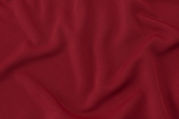 Sportowej odzieży tkaniny tekstury tło. czerwona koszulka piłkarska
