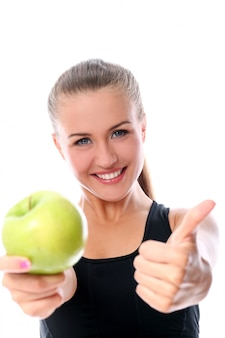 Sportowy kobieta z jabłkiem