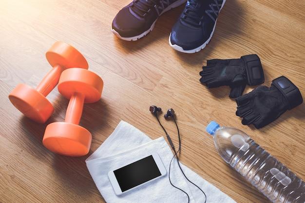 Sprzęt fitness na drewniane tła