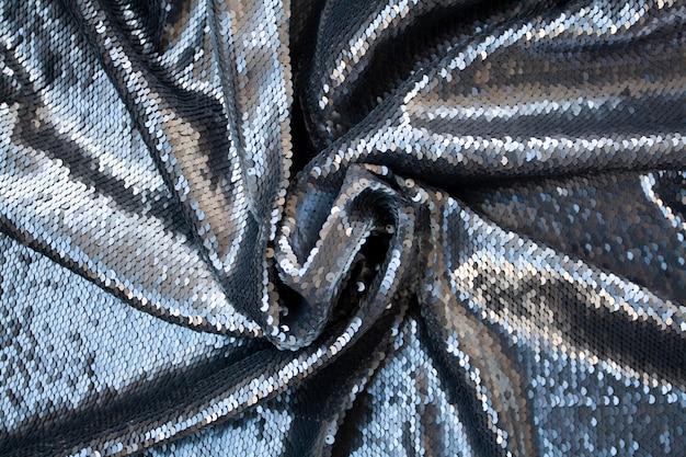 Srebrna błyszcząca świąteczna tkanina