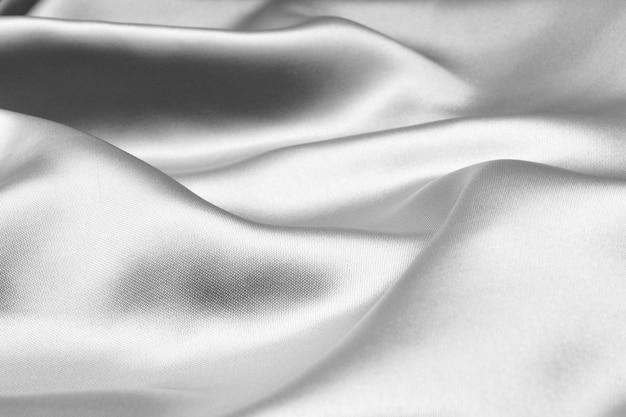 Srebrna falista jedwabna tekstura tło