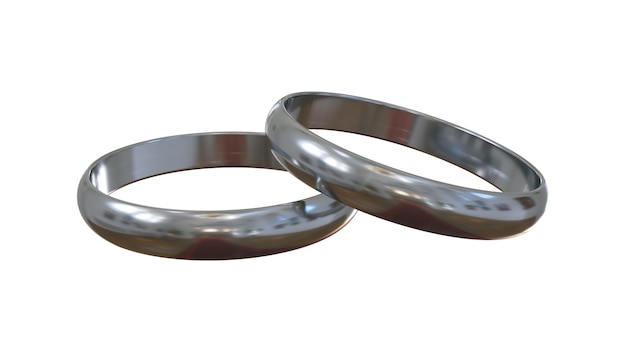 Srebrne pierścionki zaręczynowe na białym tle. jeden nad drugim.