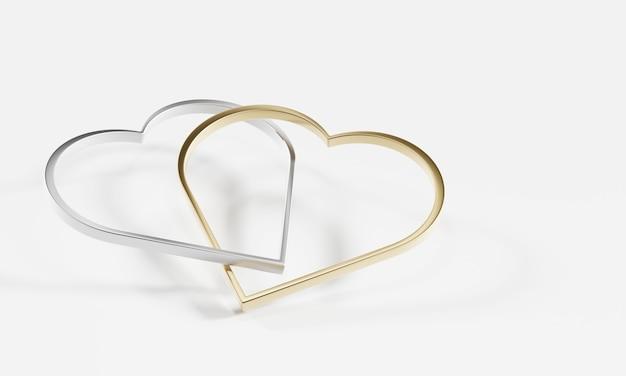 Srebrny i złoty pierścionek w kształcie serca oprawione razem