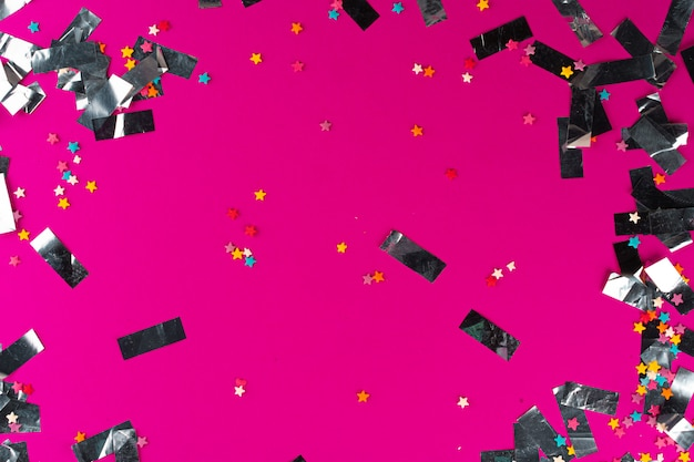Srebro błyszczy blichtr na różowym tle