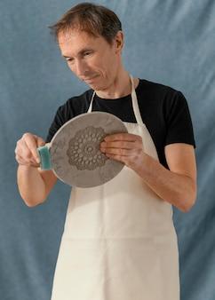 Średnio strzałowy talerz do czyszczenia człowieka