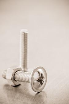 Śruby narzędzia na tekstury tła metalu