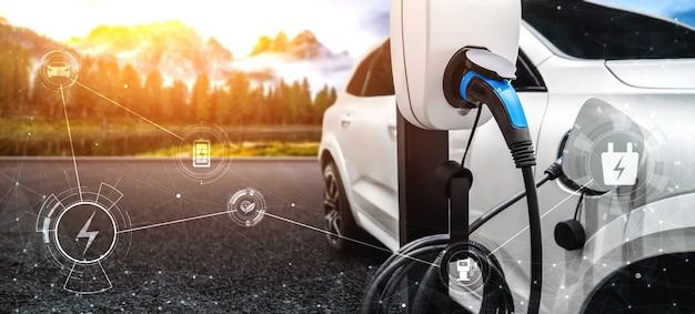 Stacja ładowania samochodów elektrycznych w koncepcji zielonej energii i ekologicznej podróży