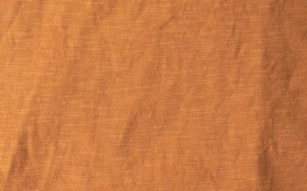 Stałe tło tekstury tkaniny w kolorze terakoty