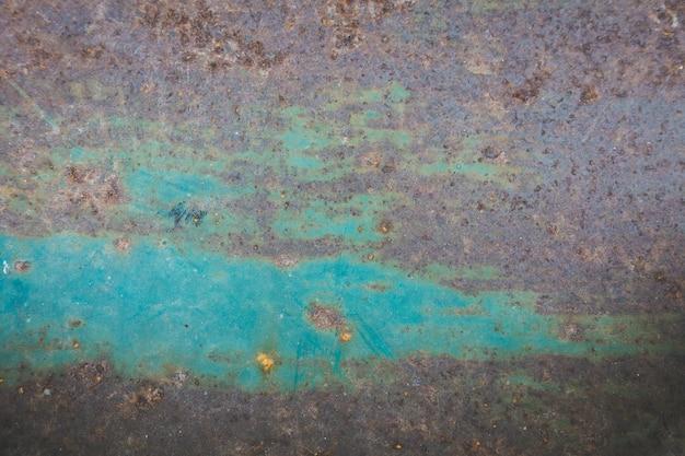 Stalowa powierzchnia rdzy i zadrapania są pomocne w tle.