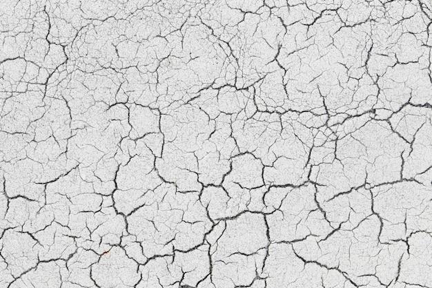 Stara asfaltowej drogi powierzchnia tekstura z krakingowym.