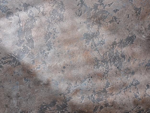 Stara brązowa tekstura grunge z naturalnym światłem
