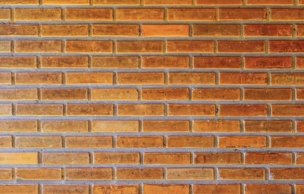 Stara cegła izoluje tło brudną ścianę. abstrakcyjny