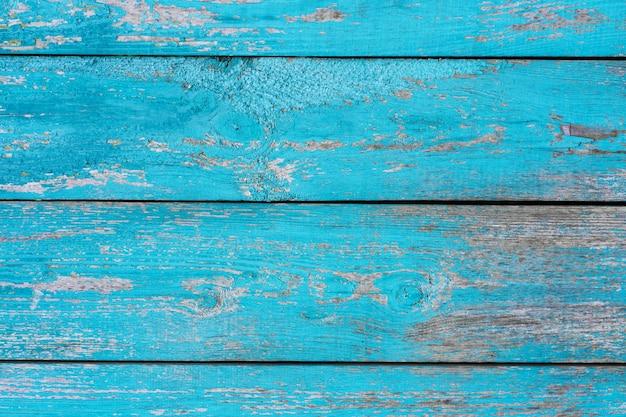 Stara drewniana płotowa błękitna farby obierania deski tekstura. tło