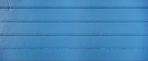 Stara drewno deska malował błękitnego tło
