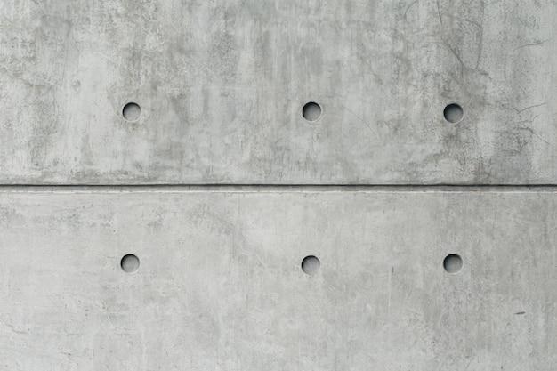 Stara grungy tekstura, szary solidny betonowy mur wysoki detal