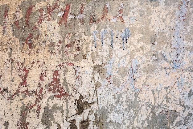 Stara krakingowa farba na ścianie. grunge zardzewiały tekstury.