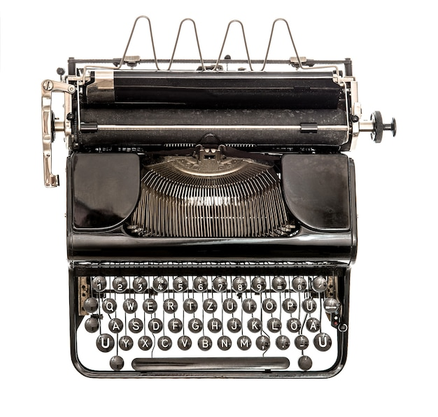Stara maszyna do pisania na białym tle. obiekt zabytkowy. widok z góry