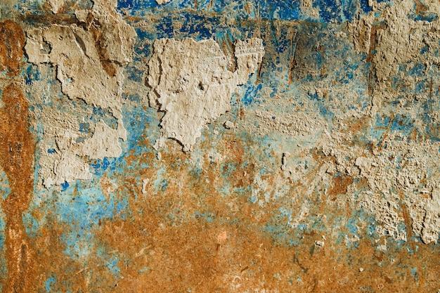 Stara metalowa powierzchnia.metal z niebieską farbą i rdzą. tekstura starego metalu.