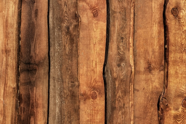 Stara nieociosana drewniana płotowa tekstura.