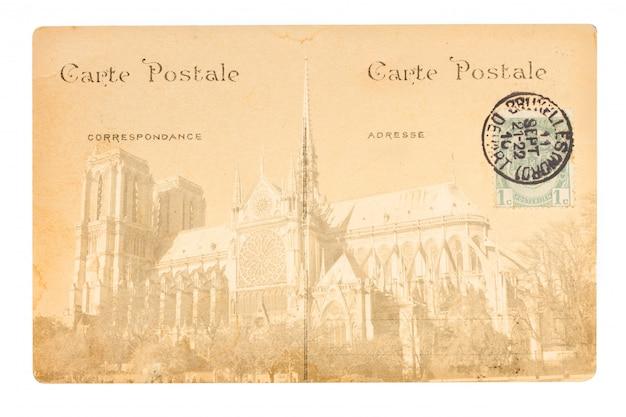 Stara pocztówka paryża z kościołem notre dame.