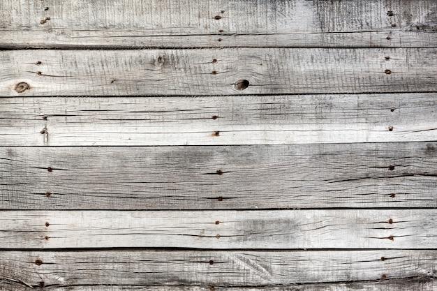 Stara szara drewniana tekstura lub tło.