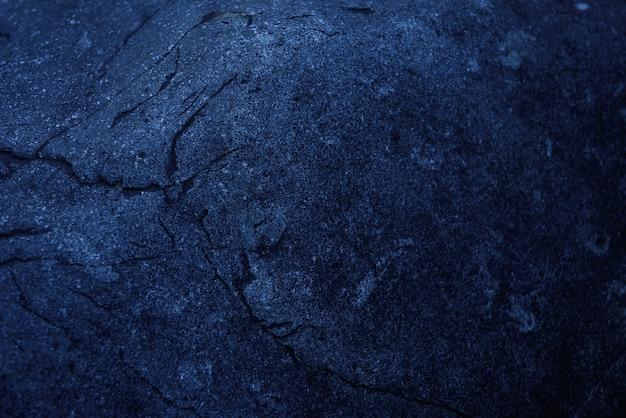 Stara szorstka powierzchnia z czarnego granitu