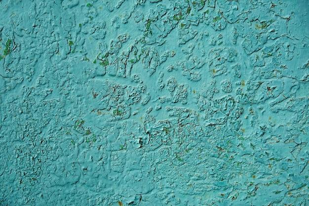 Stara zardzewiała i porysowana powierzchnia żelaza - grunge zielona tekstura lub tło, metal z zadrapaniami