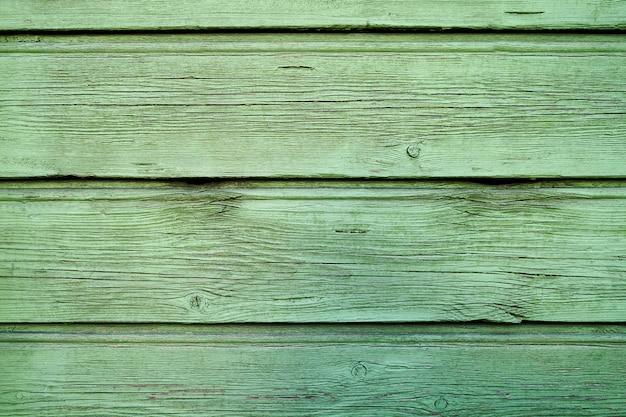 Stara zielona drewniana tekstura z naturalnymi wzorami. skopiuj miejsce