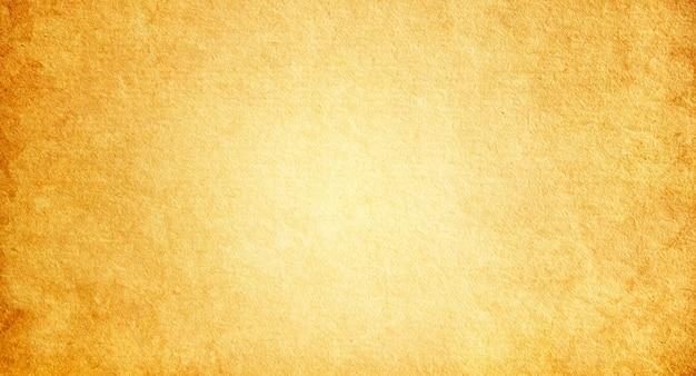 Stare brązowe i żółte tło papieru z miejscem na kopię i miejscem na tekst