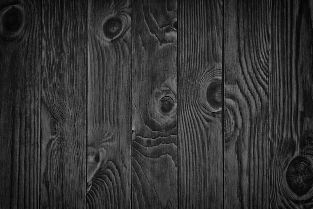 Stare czarne drewno. tablica szkolna. ciemna ściana / grunge ponura drewniana tekstura