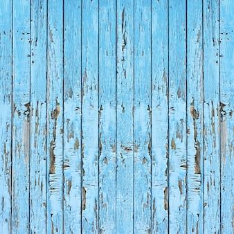 Stare drewniane deski niebieskie tło.