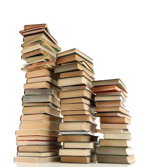 Stare książki na białym tle