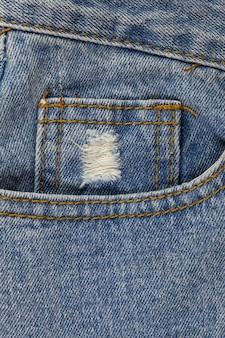 Stare niebieskie dżinsy w tle