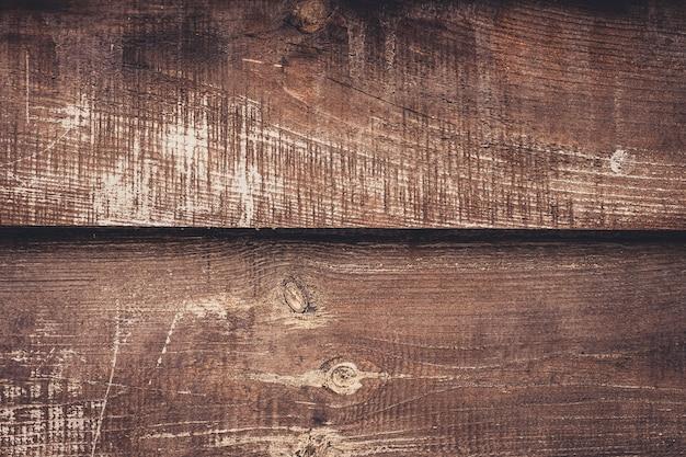 Stare odrapane drewniane deski, ciemnobrązowe tło z drewna. wyblakły stół olchy, dębu. vintage tekstury drewna, tła.