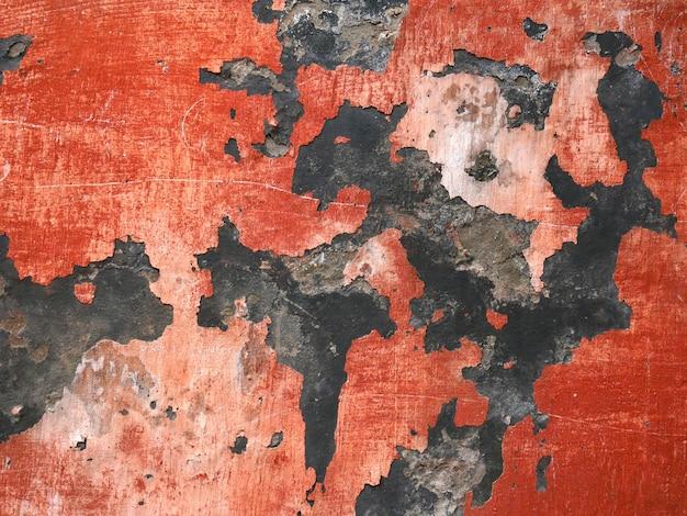 Stare ściany budynków, starzejąca się tekstura i tło pęknięta farba i stiuk