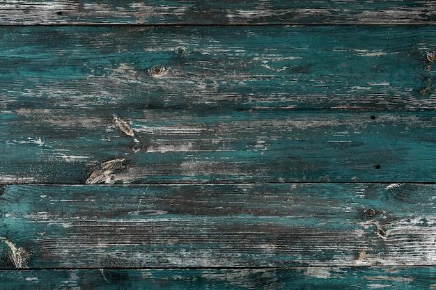 Stare tło drewna. zbliżenie na ścianę z desek drewnianych farbą zieloną