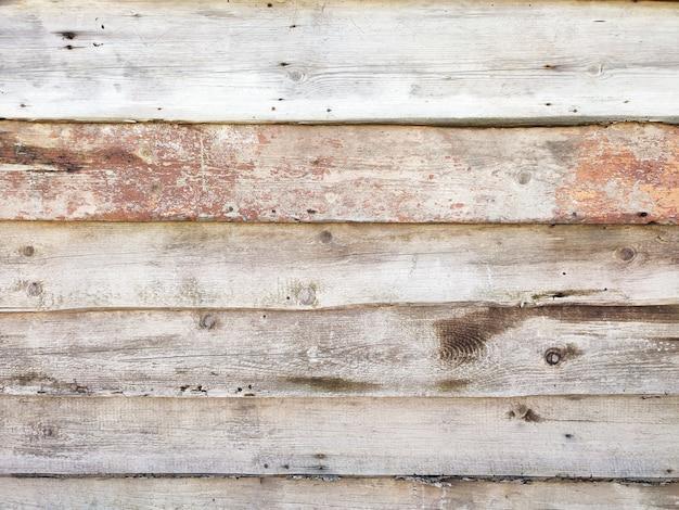 Stare wyblakłe drewniane beczki, deski lub fakturowana powierzchnia ogrodzenia