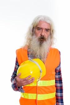 Starszy brodaty mężczyzna robotnik budowlany