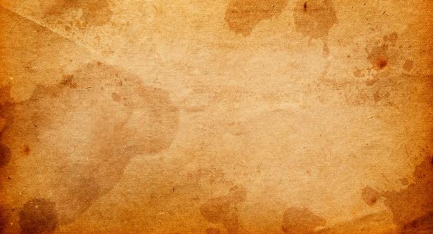 Stary brązowy papier z plamami i smugami do projektowania z miejscem na tekst