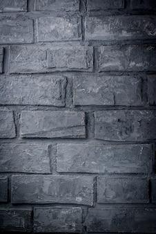 Stary ciemny szary ściana z cegieł, tło