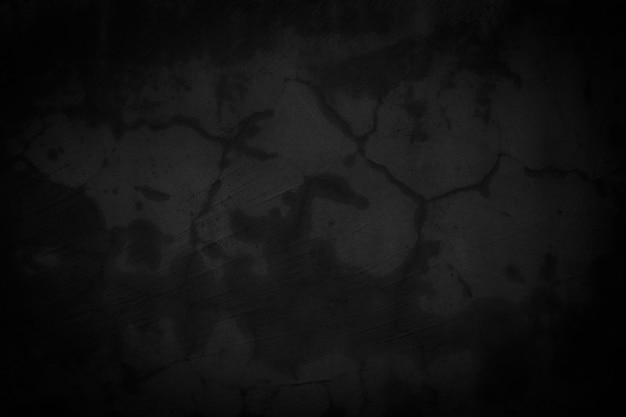 Stary czarny beton lub tekstura ściany z trudnym projektem tła