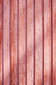 Stary czerwony grunge pęknięty drewniany płot panele drewniane