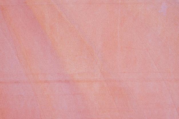 Stary czerwony piasek kamiennej ściany tekstury tło.