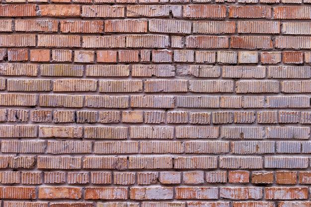 Stary czerwony ściana z cegieł, nieociosana tekstura