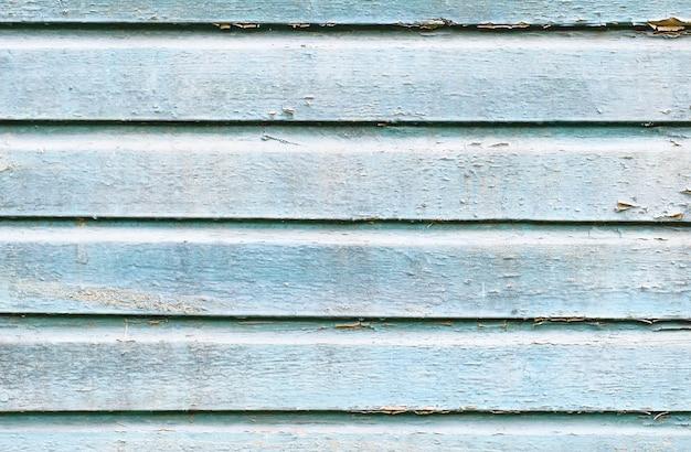 Stary drewniany malowany bławy nieociosany tło, farby obieranie