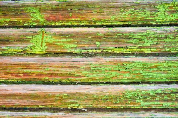 Stary drewniany tło malujący w zieleni.